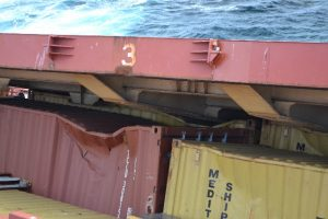 Containers can be seen pushing up the hatch covers in the bow section - photo credit LOC