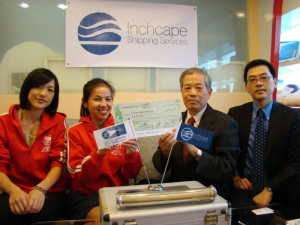 ISS Taiwan General Manager, Joeson Wei presenting the company's donation to representatives of the Child Welfare League Foundation