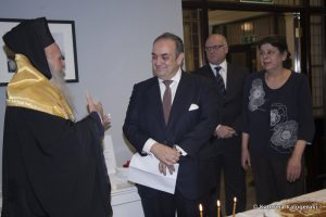 Archbishop Gregorios blessing GSCC's Chairman Harry J. Fafalios. At the back the director of the Committee Commodore (Rt.HCG) Costas Amarantidis and Sylvana James