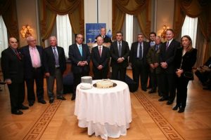 H.E.-Ambassador Daniel Bennett Smith along with Mr.Mousouroulis Mr.Michaloliakos the Board of Governors-and Past Presidents for theVasssilopitta Cutting