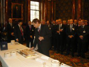 Lloyd's register's Chairman Thomas Thune Andersen cutting the Vassilopitta