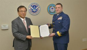 l to r: ClassNK Executive Vice President Dr. Takuya Yoneya  receives a copy of the Recognized Organization Agreement from U.S. Coast Guard Rear Admiral Joseph A. Servidio.