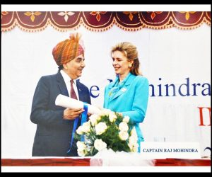 Capt Mohindra is congratulated by Queen Noor of Jordan on his educational work