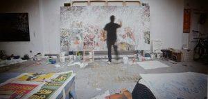 "José Parlá, Work in progress in his Brooklyn studio on the painting Udaipur. ""Broken Language"" 2013, Haunch of Venison gallery. Photo credit: Chris Mosier, 2013."