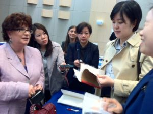 IMO's Pamela Tansey on the left, is interviewed by reporters and delegates on the development of a global strategy for women seafarers.