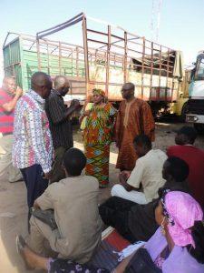 Seminar participants talking to truck drivers in Cotonou, Benin.
