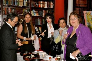 Yoshinori Hatta invites guests to sample Matsuri Restaurant sushi.  Maria  Dixon, president of WISTA-UK, is on the right, with Maria Ester Bobadilla of Patton Moreno next to her