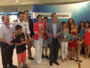 The inauguration of the Exhibition (from left to right): Mr. N. Fronas/Chairman of the Modern Greek Art Museum, Captain G. Seferiadis/Central Harbour Master of Rhodes, Mr. C. Triantafillou/HELMEPA's Environmental Awareness Section, Ms. A. Hadjinikita-Kampouri/Director of the Volunteer Office of Rhodes, Mr. S. Kousournas/Mayor of Rhodes and the award-winning students.