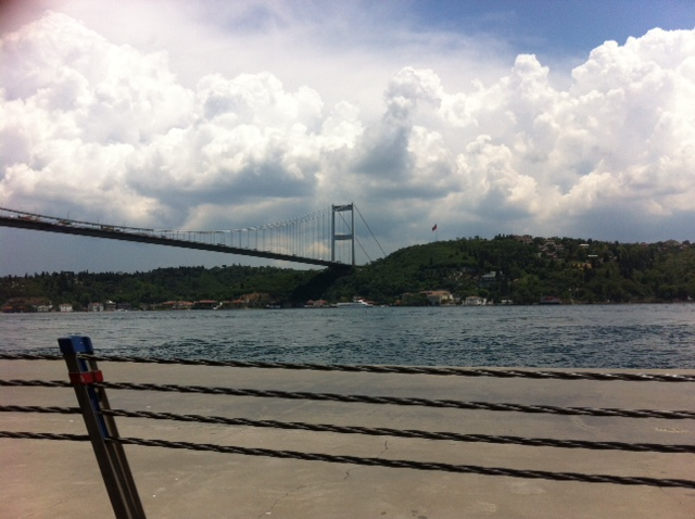 ...clouds over the Straits of Bosporus, with it famous bridge linking Europe and Asia. Photo credit Anny Zade