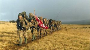 British troops trudging across the rugged Falkland Islands, 1982