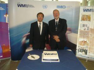 IMO's Secretary-General Koji Sekimizu with professor Bjorn Kjerfve, President WMU about to cut the 30 years anniversary cake