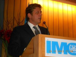 Greece's Shipping Minister Miltiades J. Varvitsiotes addressing the IMO's General Assembly