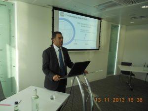 Dr. Rahim at the podium delivering his slides presentation