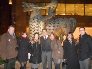 front Denys Mitchell's magnificent 'The Cnihtengild'  horse monument set in the midst of the old warehouses of the East India Company. From left to right: Sean Gay, Kristina Narvidaite, Sarah Caldwell, Claudio Chiste, Marina Burima, Magda Garcia and Andrea Hilides.