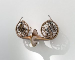 French Kiss. Double French horn, lacquered brass body. By artist mentalKLINIK. Courtesy of Gallery Isabelle van den Eynde.
