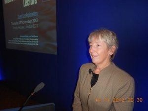 Professor Cindy Lee Van Dover at the podium delivering her slides speech