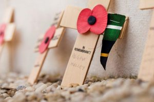 Wooden crosses with poppy. Copyright the In Flanders Fields Museum.