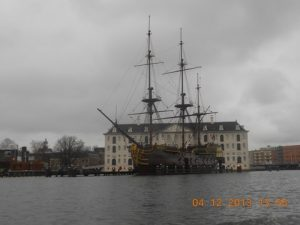 """A view of the museum with the VOC ship """"Amsterdam"""" at the forefront."""