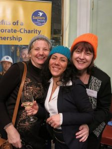 Martine Frost, Eleonora D'Orio and Jean Winfield getting into the woolly hat spirit