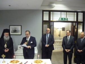 The Chairman of GSCC Harry J. Fafalios delivers his message with Archbishop Gregorius on the left and Captain (Rt.HCG) Costas Amarantidis, H.E. The Greek Ambassador Constantinos Bikas and Emeritus Secretary-General of the IMO Adm (Rt.HCG) Efthimios Mitropoulos