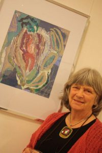 Wendy Roberts with her mixed media work Jurassic Coast