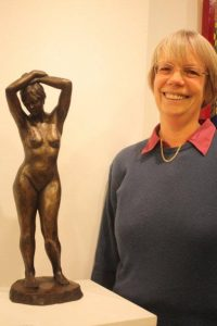 Moira Purver with her bronze resin sculpture Moment to Ponder.