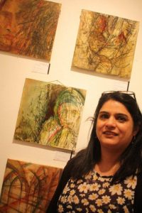 Irtiqa with her mixed media works.