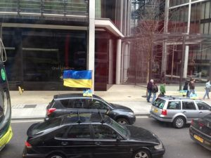 So what can you see behind the Ukrainian flag?