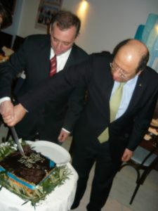 The Greek Ambassador and the Cyprus High Commissioner cutting the cake...err The Vassilopita