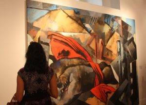 """A guest at the private view admires the oil painting """"Unbound"""", by Elisabeth Lalouschek."""