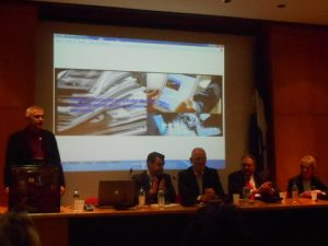 The panel, with Prof. Chlomoudis (standing), Eleias Bissias, Nigel Lowry, David Glass and Gillian Whittaker