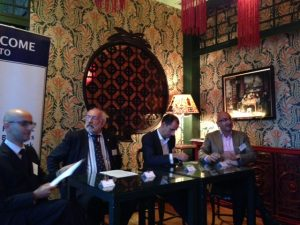 The panel, with Chairman Dimitris Belbas, Guest speaker John Faraclas with discussants Christos Tsakonas and George Kypraios
