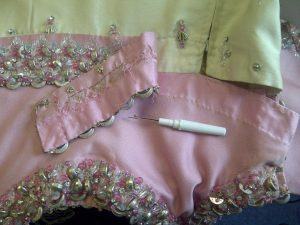 Working on a Rahvis couture dress.