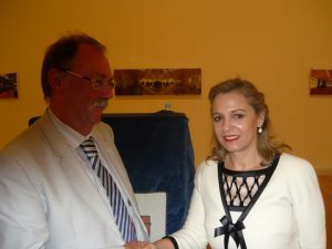 The winner of the Runcimn Award Prof. Roderick Beaton having just received the award from Ms Vassiliki Campbell CEO of the National Bank of Greece London Branch