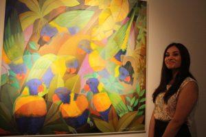 Kajoli Khanna of Grosvenor Gallery admires the painting Lorikeets by Senaka Senanayake.