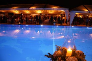 A view of Ekali Club's pool and the right ..embankment  with guests