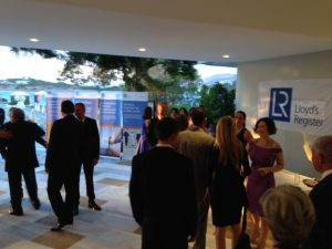 Guests entering the reception area and being cordially greeted by the Lloyd's Register team
