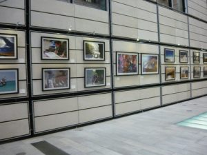 A view of the exhibited pictures at the east sector of the atrium