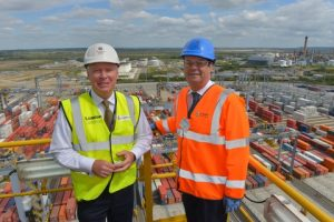 Simon Moore, London Gateway CEO and Rt Hon. Stephen Hammond MP look out over the busy port while a container ship is unloaded