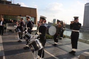 Band of London Borough of Sutton Sea Cadets, TS Puma, entertain guests on IMO terrace.