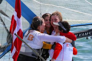 Gold and silver 49erFX embrace (c) ISAF