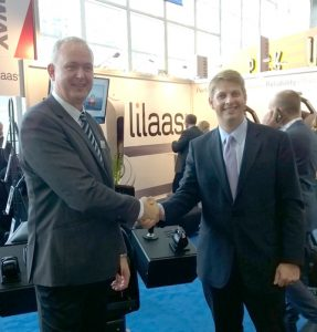 Lilaas Managing Director Øyvind Lilaas (left) and Alex Larsen, Imtra VP Commercial Sales, shake hands on the deal that is expected to open up the North American market to Lilaas controls