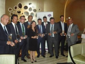 The sponsors holding hteir award with ATHEX's CEO Socrates Lazaridis (fourth from the left)
