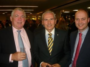 Captain Esteban Pascha, flanked by Inmarsat's Frank J. Coles and Guy Sear