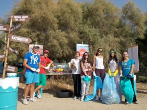 Students from the Geitona Private School explore MIO-ECSDE's mobile exhibition on marine litter after the beach cleanup at the Peace and Friendhip Stadium