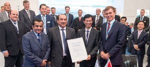 """Tor Svensen, CEO of DNV GL Maritime, presents the Approval in Principle for the first """"LNG Ready"""" mega box ships to Mr. Oi Hyun Kim, CEO and COO, of HHI's Shipbuilding Division and Mr. Waleed Al Dawood, COO of United Arab Shipping Company, in the presence of His Excellency Sheikh Ali Bin Jassim Al Thani, UASC Board Member."""
