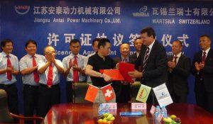 The agreement was signed by Mr Chen Guochong, Chairman JAD and Mr Martin Wernli, Vice President, 2-stroke, Wärtsilä Ship Power and Managing Director of Wärtsilä in Switzerland.