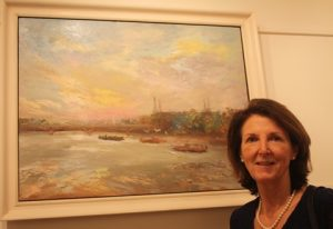 Lynda Minter and her oil on canvas Battersea Power Station, early morning.