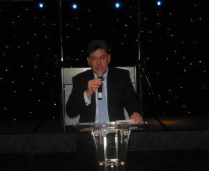 Dimitris Monioudis, president of the HESGB, pre-announcing the event