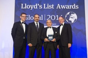 Ravi Mehrotra, thierd from the left holding his trophy with Lloyd's List Managing Editor  Richard Meade on the  left